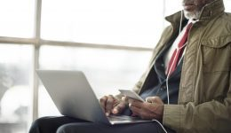 Businessman Using Laptop Mobile Sitting Concept